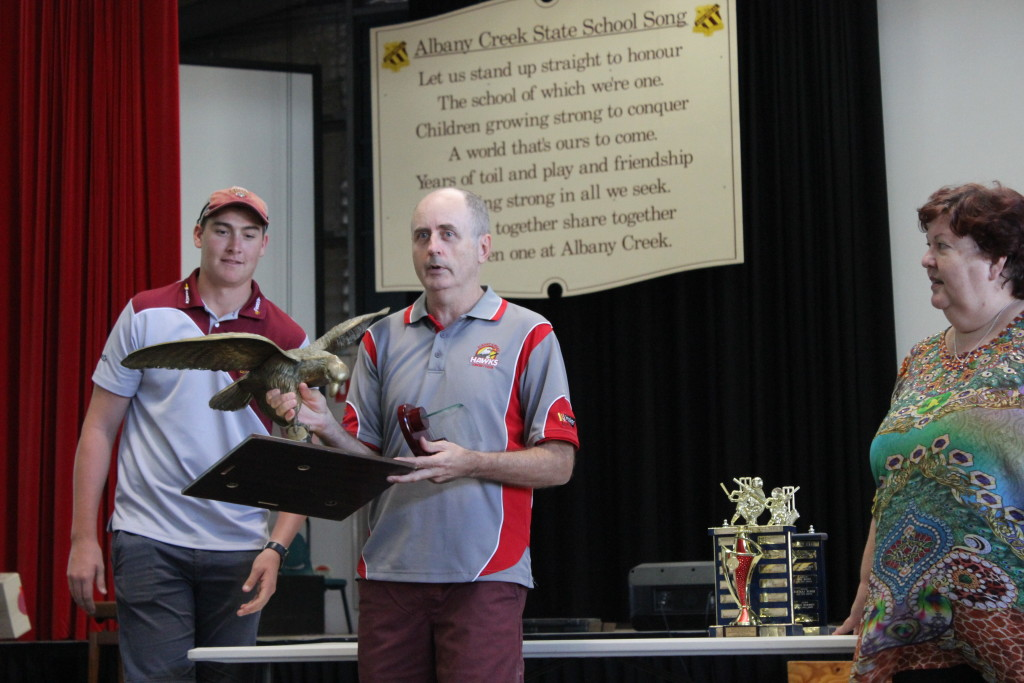 "John Murray receives the ""Big Bird"" trophy, awarded with life membership of the club"